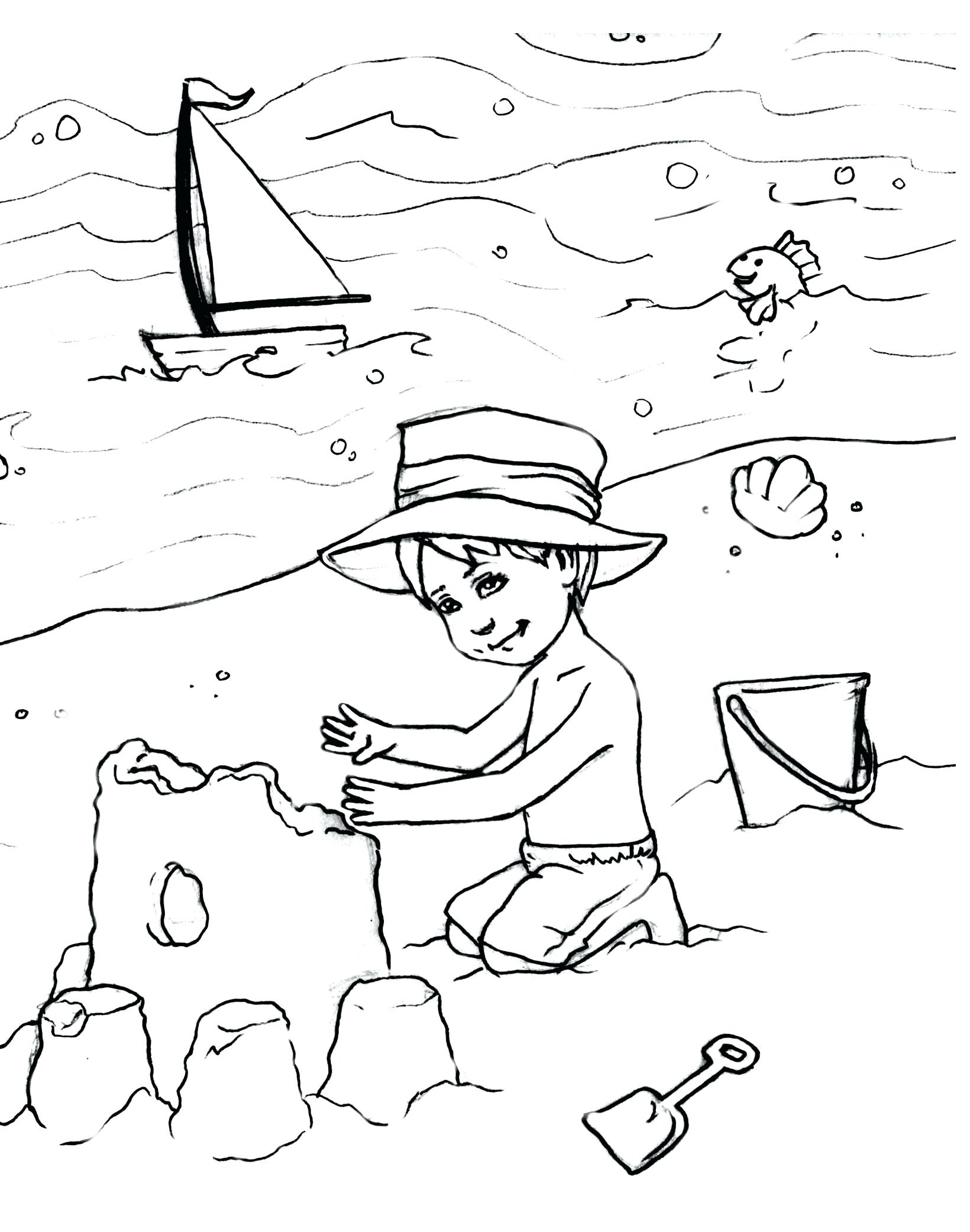 A Boy Building A Sand Castle